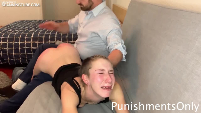 Nude woman crying spanked